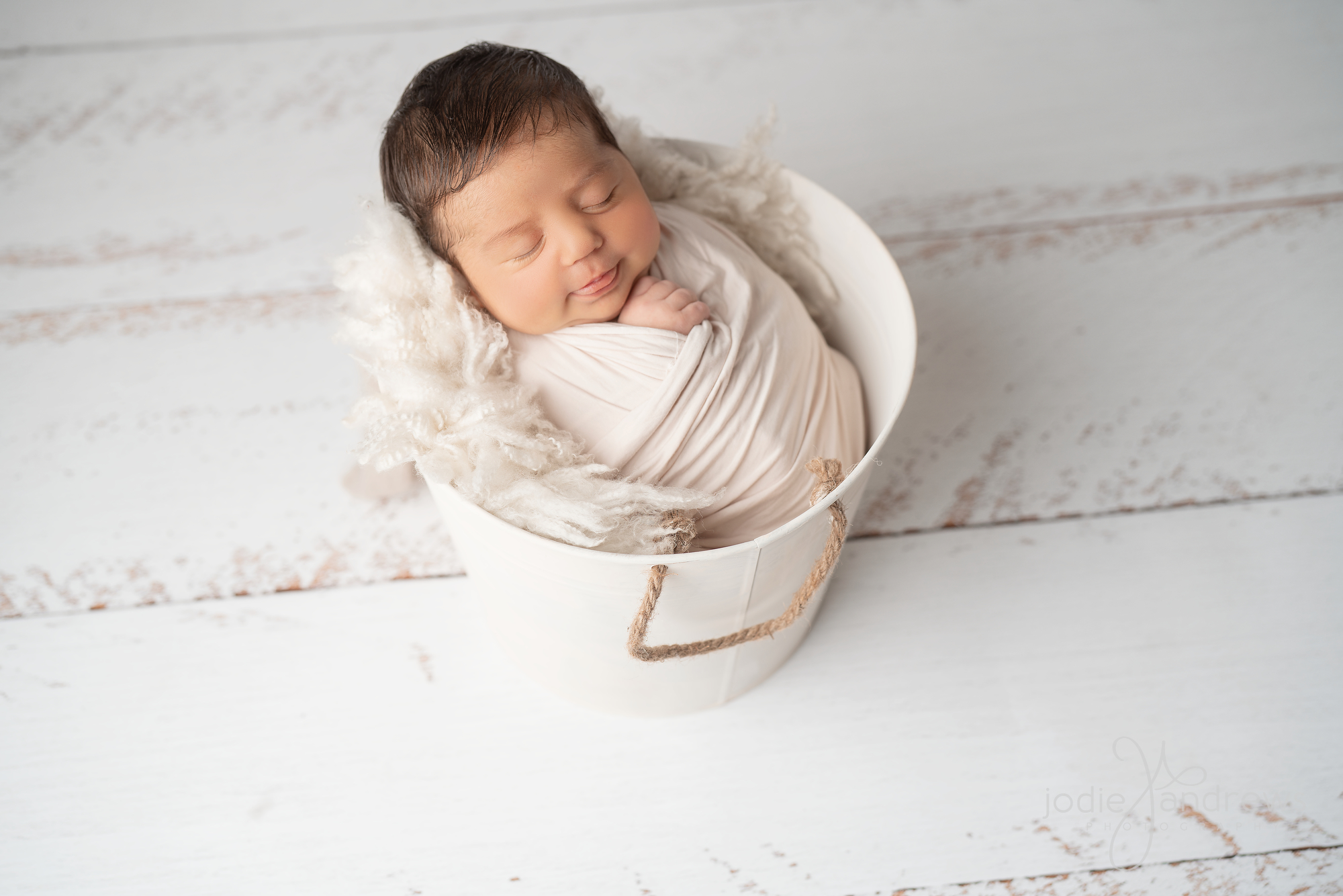 Baby Boy in White Bucked on White Rustic Timber Floor